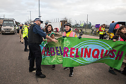 London, UK. 8 December, 2019. Police officers prevent climate activists from Extinction Rebellion from blocking the road outside Heathrow airport during a Bikes Against Bulldozers protest against Heathrow expansion and the greenwashing of climate commitments by political parties. The protest took the form of a Critical Mass bicycle ride from Hyde Park followed by a lie-in in front of a bulldozer to which Boris Johnson and John McDonnell were invited in order to fulfil their pledge of lying down in front of bulldozers to be used for Heathrow expansion.