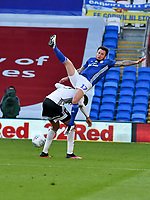 Football - 2019 / 2020 Championship - Play-off semi-final - 1st leg - Cardiff City vs Fulham<br /> <br /> Lee Tomlin of Cardiff City is upended <br /> in a match played with no crowd due to Covid 19 coronavirus emergency regulations, in an almost empty ground, at the Cardiff City Stadium<br /> <br /> COLORSPORT/WINSTON BYNORTH