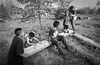 Children playing at fishcamp.  Subsistence activities near the village of Kethluk in southwest Alaska.
