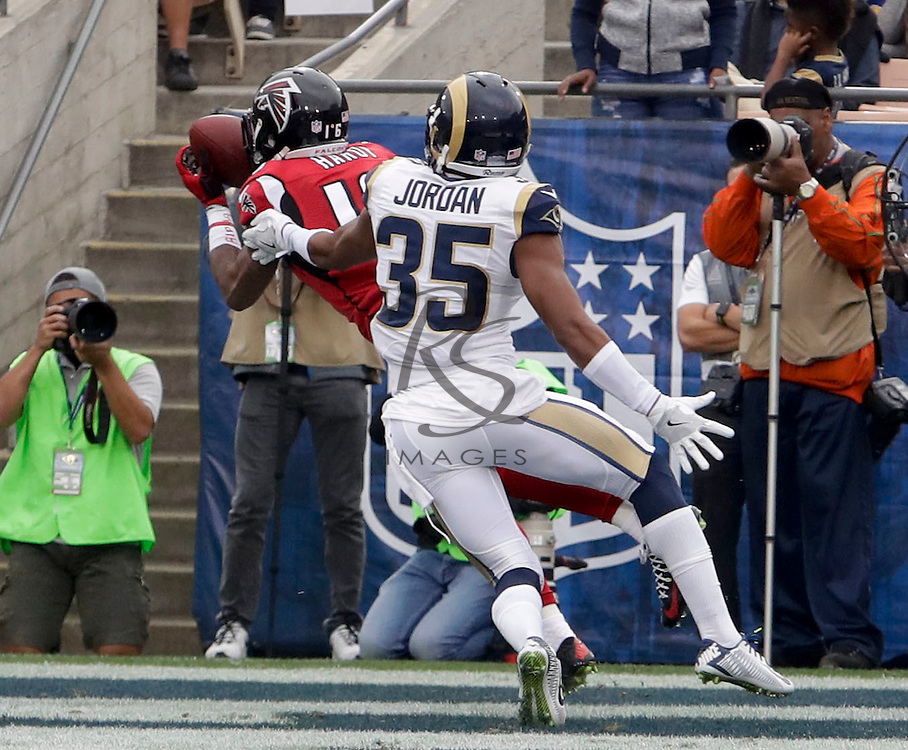 Atlanta Falcons wide receiver Justin Hardy catches a touchdown pass under pressure by Los Angeles Rams defensive back Michael Jordan, left, during the first half of an NFL football game Sunday, Dec. 11, 2016, in Los Angeles. (AP Photo/Rick Scuteri)