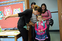 Jianna Keen, 5, gets her place pointed out by Mrs. Hoffman on Wednesday, August 14, the first day of the fall semester at Spreckels Elementary School.