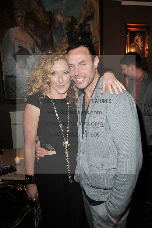 KELLY HOPPEN and JASON GARDINER at a party to celebrate the publication of her new book - Kelly Hoppen: Ideas, held at Beach Blanket Babylon, 45 Ledbury Road, London W11 on 4th April 2011.