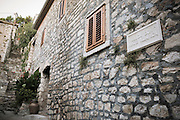 Shuttered window and street sign, Skradin, Dalmatia, Croatia