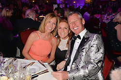 Left to right, PAULA CAUDWELL, SARAH, DUCHESS OF YORK and BRIAN CAUDWELL at the Caudwell Children's annual Butterfly Ball held at The Grosvenor House Hotel, Park Lane, London on 15th May 2014.