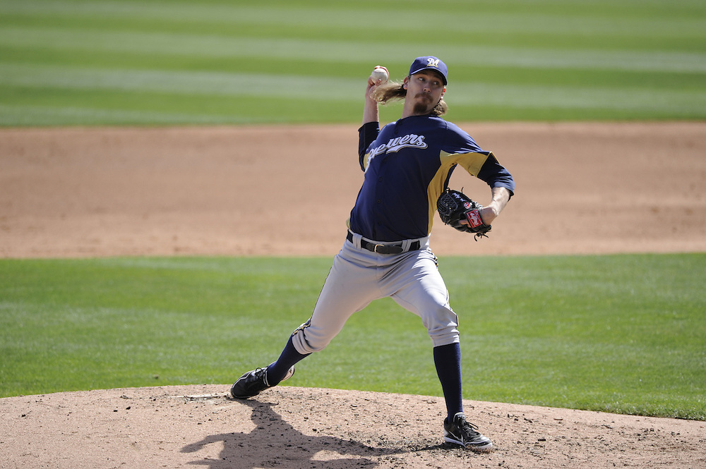 GLENDALE, AZ - MARCH 07:  John Axford #59 of the Milwaukee Brewers pitches against the Chicago White Sox on March 7, 2012 at The Ballpark at Camelback Ranch in Glendale, Arizona. The Brewers defeated the White Sox 10-6.  (Photo by Ron Vesely)  Subject:  John Axford