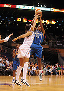 June 10, 2010; Phoenix, AZ, USA; Minnesota Lynx forward Rebekkah Brunson puts up a shot against Phoenix Mercury forward Tangela Smith during the first half in at US Airways Center.  Mandatory Credit: Jennifer Stewart-US PRESSWIRE