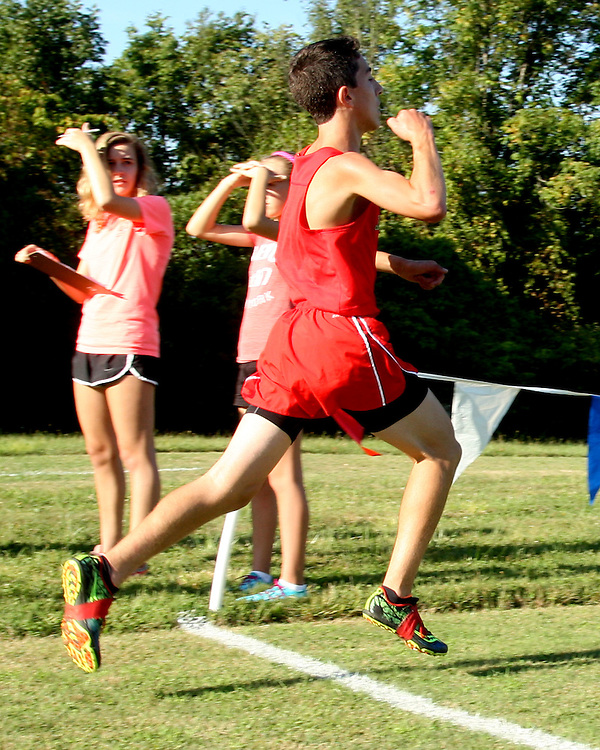 Jamestown's Michael Peppy crosses the finish line winning the cross county match at Southwestern 9-15-15 photo by Mark L. Anderson