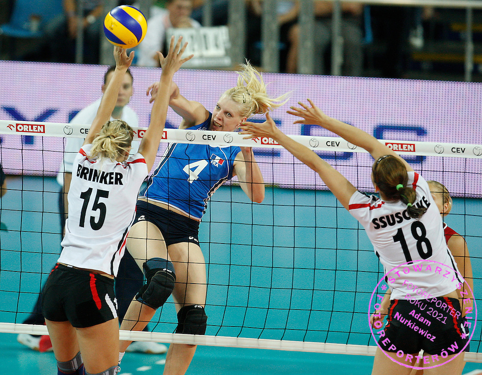 WROCLAW 26/09/2009.WOMEN'S EUROPEAN VOLLEYBALL CHAMPIONSHIPS.Christina Bauer of France spikes as Maren Brinker /L/ and Corina Ssuschke of Germany try to block during the match at the Women's European Volleyball Championships in Wroclaw.PHOTO / PIOTR HAWALEJ / WROFOTO