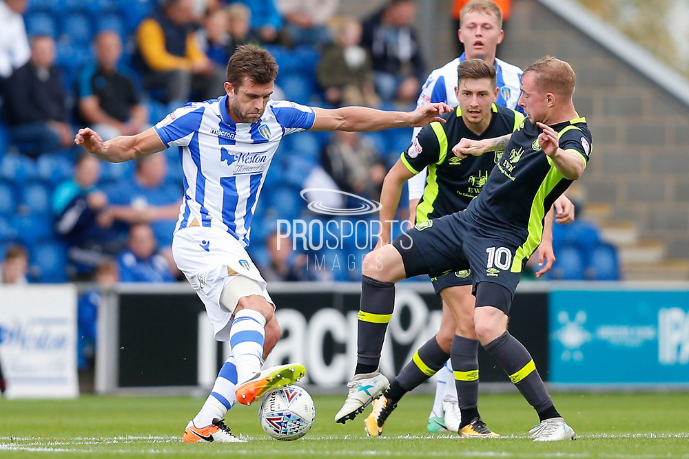 Carlisle United's Nicholas Adams  makes a tackle on Colchester United's Doug Loft(8) during the EFL Sky Bet League 2 match between Colchester United and Carlisle United at the Weston Homes Community Stadium, Colchester, England on 14 October 2017. Photo by Phil Chaplin