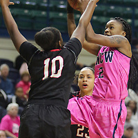 UNCW's Brie Mobley shoots over Northeastern's Kazzidy Stewart Sunday February 15, 2015 at Trask Coliseum. (Jason A. Frizzelle)