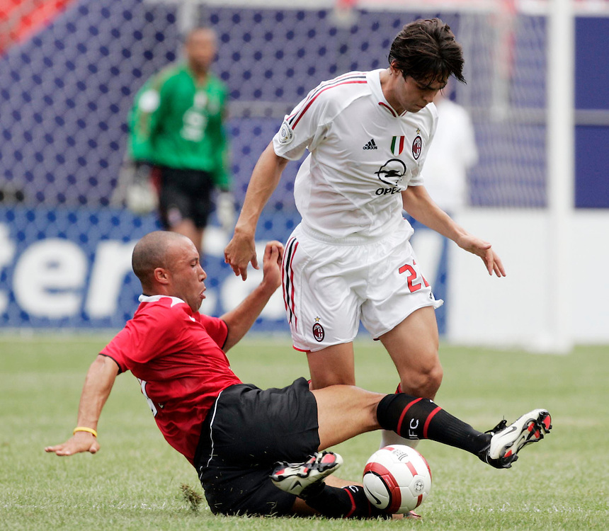 Manchester United's Mikael Silvestre slide tackles Kaka of  AC Milan in East Rutherford, NJ Saterday 31 July 2004. .EPA/ANDREW GOMBERT