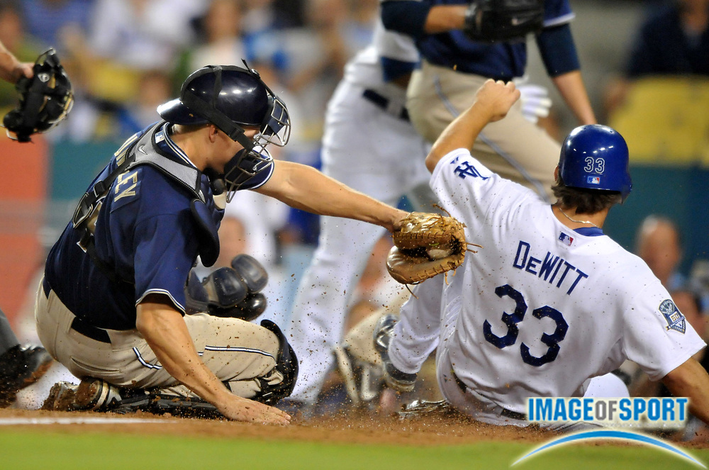 Sep 23, 2008; Los Angeles, CA, USA; Los Angeles Dodgers infielder Blake DeWitt (33) beats the tag of San Diego Padres catcher Nick Hundley (4) to score in the third inning at Dodger Stadium.
