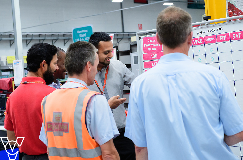 Two delivery offices, Oadby and Leicester South, which are both based inside the Leicester Mail Processing Unit building, have passed the penultimate gateway of One Plan.  One Plan is a business programme designed to have a standardised operation of excellence.  Pictured is Shahbaaz Khan working with colleagues, from right to left, Keith Bedford, Ian Rosewarne, Shuaib Chowdhury and Collis Shepherd.<br /> <br /> Picture: Chris Vaughan Photography<br /> Date: July 7, 2017