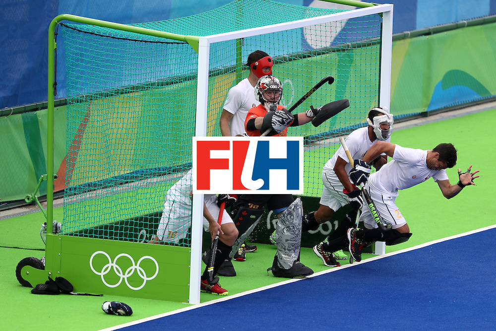 RIO DE JANEIRO, BRAZIL - AUGUST 12:  Team Canada runs from the goal against India during a Men's Preliminary Pool B match on Day 7 of the Rio 2016 Olympic Games at the Olympic Hockey Centre on August 12, 2016 in Rio de Janeiro, Brazil.  (Photo by Sean M. Haffey/Getty Images)