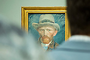 Visitors viewing self portrait by Vincent Van Gogh at Rijksmuseum, Amsterdam, Holland
