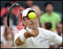 Image ©Licensed to i-Images Picture Agency. 28/06/2014. Wimbledon, London, United Kingdom. Santiago Giraldo V Rodger Federer on centre court on Day 6 of the Wimbledon Championships. Picture by Andrew Parsons / i-Images