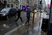 Storm Georgina swept across parts of Britain and in central London, lunchtime office workers were caught out by torrential rain and high winds, on 24th January 2018, in London, England. Pedestrians resorted to leaping across deep puddles at the junction of New Oxford Street and Kingsway at Holborn, the result of overflowing drains. Seventh in a sequence of seven photos.