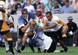Dean Grant is tackled by JD Moller and  Anton Van Zyl during the Festival of Rugby match between The Boland Cavaliers and The Stormers held at The Cape Town Stadium (formerly Green Point Stadium) in Cape Town, South Africa on 6 February 2010.  This is the first match/event to be held at the new stadium which was purpose built to host matches during the FIFA World Cup South Africa 2010.Photo by: Ron Gaunt/SPORTZPICS