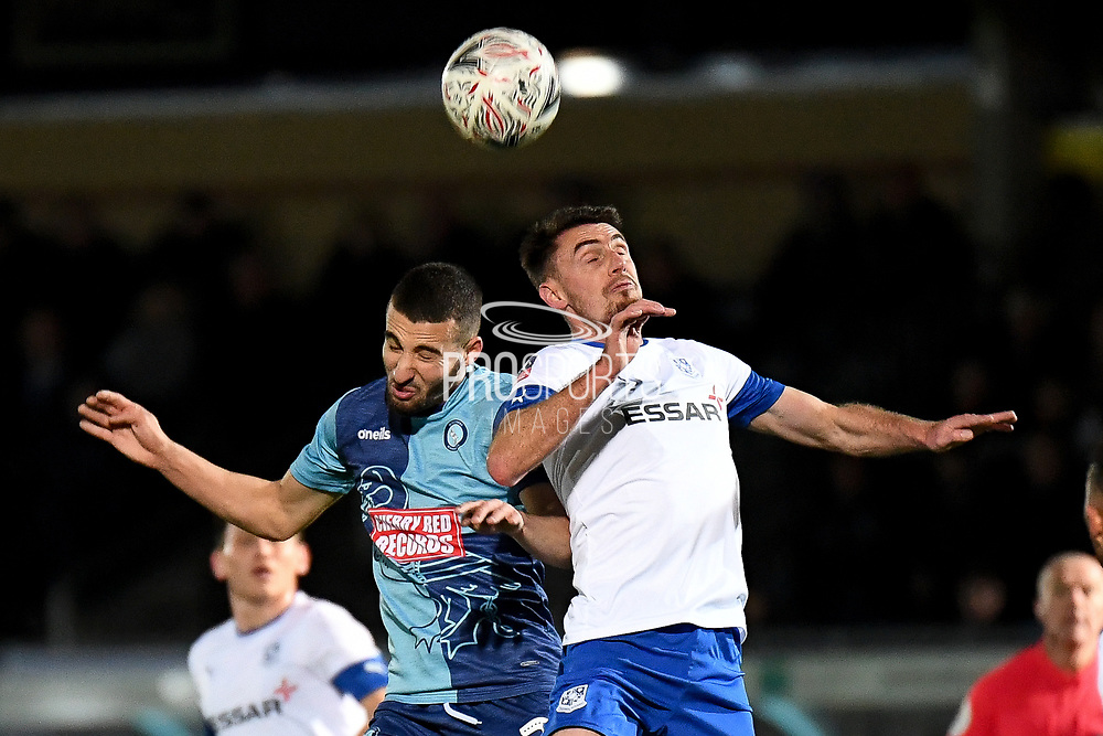 Wycombe Wanderers midfielder Nick Freeman (22) battles for possession  with Tranmere Rovers midfielder Darren Potter (8) during the The FA Cup match between Wycombe Wanderers and Tranmere Rovers at Adams Park, High Wycombe, England on 20 November 2019.