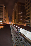 Heading into the darkness of a late night in Chicago's Loop, yet another CTA El train departs from the Adams/Wabash station.