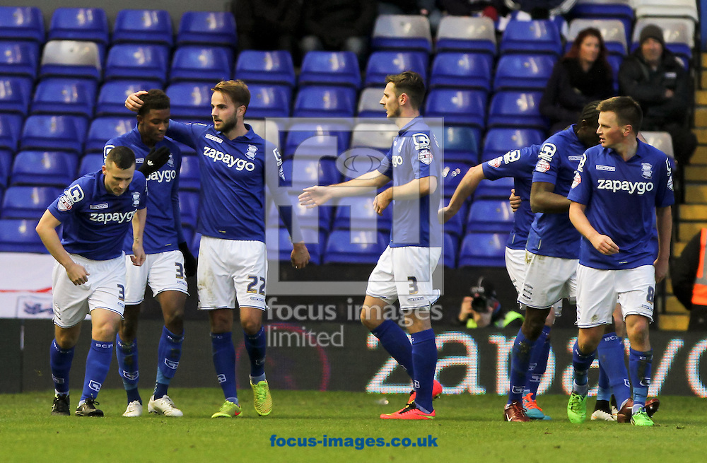Demarai Gray (2nd left) of Birmingham City celebrates scoring his sides fourth goal with his team mates during the Sky Bet Championship match at St Andrews, Birmingham<br /> Picture by Tom Smith/Focus Images Ltd 07545141164<br /> 13/12/2014