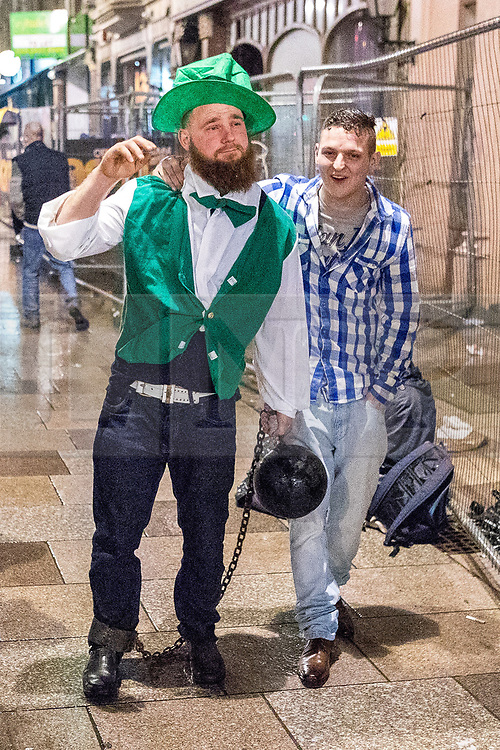 © Licensed to London News Pictures . 17/03/2017 . Cardiff , UK. Revellers on a windy and wet Saint Patrick's Day night out in Cardiff city Centre . Photo credit: Joel Goodman/LNP