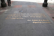 A quote from don quixote in the street in front of the house where Miguel de Cervantes Saavedra's lived in Madrid, Spain