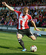 Jake Bidwell crossing the ball during the Sky Bet Championship match between Brentford and Nottingham Forest at Griffin Park, London, England on 6 April 2015. Photo by Matthew Redman.