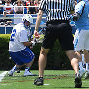 Duke Goalkeeper Luke Aaron (2) attempts to save the ball from entering the net in the 3rd quarter of a NCAA Division I Men's Lacrosse Tournament game between the defending national champion Duke and No. 8 ranked John Hopkins Sunday, May. 18, 2014 at Delaware Stadium in Newark, DEL