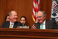 Senator Tom Harkin (D-IA) jokes with Senator Lamar Alexander (R-TN) during a Health, Education, Labor, And Pensions Committee hearing in the Dirksen Senate Office Building in Washington, DC on Thursday, April 11, 2013. Senator Harkin is the chairman and Senator Alexander the ranking member of the HELP Committee.