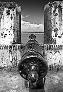 Old cannon aimed towards entrance of San Juan bay