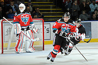KELOWNA, CANADA, OCTOBER 26:  Adam Brown #1 of the Kelowna Rockets defends the net as Cody Chikie #14 of the Kelowna Rockets skates for the puck as the Prince George Cougars visit the Kelowna Rockets  on October 26, 2011 at Prospera Place in Kelowna, British Columbia, Canada (Photo by Marissa Baecker/Shoot the Breeze) *** Local Caption *** Adam Brown; Cody Chikie;