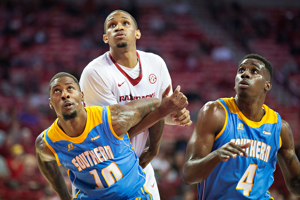 FAYETTEVILLE, AR - NOVEMBER 13:  Shawn Prudhomme #10 and Chris Thomas #4 of the Southern University Jaguars block out Keaton Miles #55 of the Arkansas Razorbacks at Bud Walton Arena on November 13, 2015 in Fayetteville, Arkansas.  The Razorbacks defeated the Jaguars 86-68.  (Photo by Wesley Hitt/Getty Images) *** Local Caption *** Shawn Prudomme; Chris Thomas; Keaton Miles