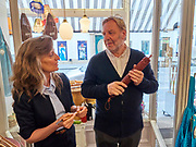 Austria, Vienna. stattGarten EIGENBEDARF concept store. Giselheid Herder-Scholz, director of Windmühlen-Messer (Solingen/Germany) presents her exclusive knives. Here talking with stattGarten EIGENBEDARF owner Christian Jauernik.