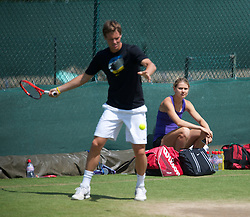 LONDON, ENGLAND - Saturday, July 3rd, 2010: Lucie Safarova, girlfriend of Tomas Berdych (CZE), watches as he practices ahead of his Men's Singles Final on day twelve of the Wimbledon Lawn Tennis Championships at the All England Lawn Tennis and Croquet Club. (Pic by David Rawcliffe/Propaganda)