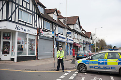 © Licensed to London News Pictures. 10/11/2015. London, UK. Police cordon off the area around the parade of shops near West Ruislip tube station after a man was fatally stabbed during Monday evening's rush hour.  Eyewitness reports indicate that the man died from a knife wounds received from a resident who lived above a nearby Tesco Express.  The stabbing took place by a post box outside security shop nearby. Photo credit : Stephen Chung/LNP