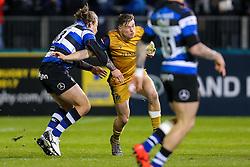 Jason Woodward of Bristol Rugby is challenged by Max Clark of Bath Rugby - Rogan Thomson/JMP - 18/11/2016 - RUGBY UNION - Recreation Ground - Bath, England - Bath Rugby v Bristol Rugby - Aviva Premiership.