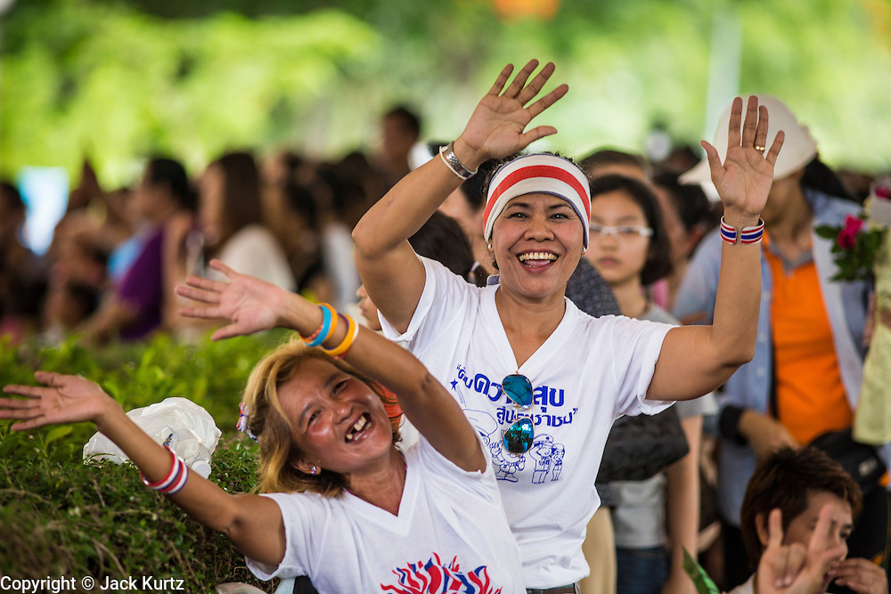 "15 JUNE 2014 - BANGKOK, THAILAND:  People cheer for a police band performing in Lumpini Park in Bangkok. The Thai military junta, formally called the National Council for Peace and Order (NCPO), is sponsoring a series of events throughout Thailand to restore ""Happiness to Thais."" The events feature live music, dancing girls, military and police choirs, health screenings and free food.  PHOTO BY JACK KURTZ"