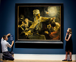 Senior Curator of Northern European Art with the 1national 1galleries of Scotland, Dr Tico Seifert (left)  puts the finishing touches to the name plate for one of the priceless paintings by Rembrandt, watched by Gallery curator Matilda Sandahl.<br /> <br /> © Dave Johnston / EEm