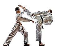 two karate men sensei and teenager student fighters fighting isolated on white background