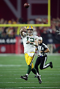 Green Bay Packers quarterback Aaron Rodgers (12) jumps in the air as he throws a deep second quarter pass during the NFL NFC Divisional round playoff football game against the Arizona Cardinals on Saturday, Jan. 16, 2016 in Glendale, Ariz. The Cardinals won the game in overtime 26-20. (©Paul Anthony Spinelli)