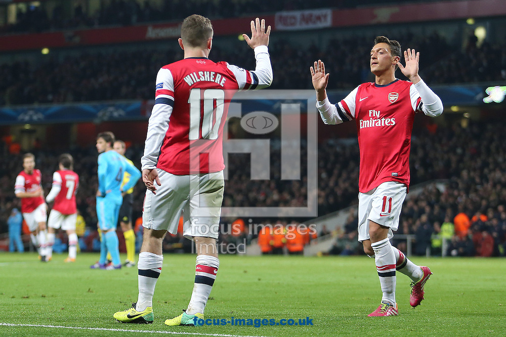 Picture by Richard Calver/Focus Images Ltd +447792 981244<br /> 26/11/2013<br /> Jack Wilshere of Arsenal celebrates his and sides second goal against Olympique de Marseille with Mesut Ozil during the UEFA Champions League match at the Emirates Stadium, London.