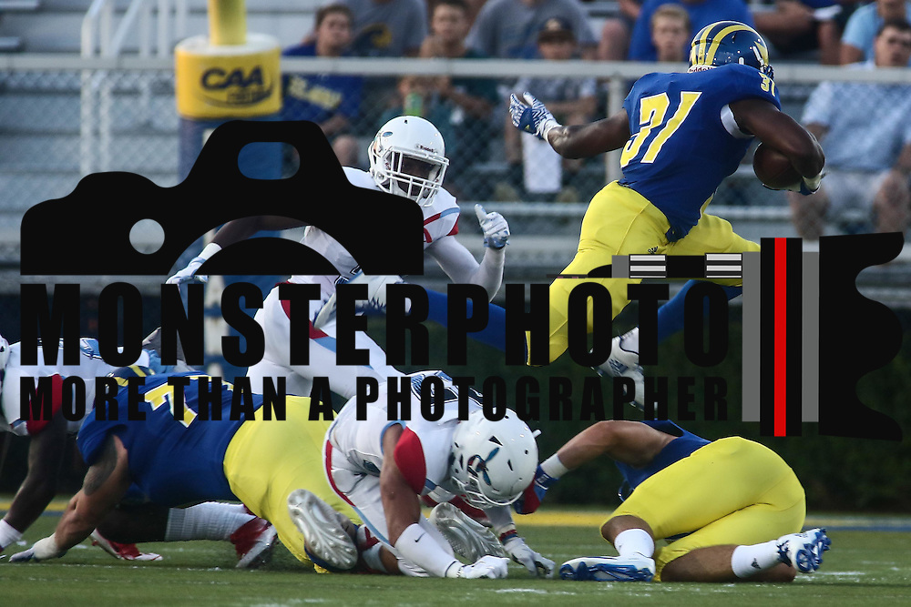 Delaware Running Back WES HILLS (31) leaps over a defender during a week one game between the Delaware Blue Hens and the Delaware State Hornets, Thursday, Sept. 01, 2016 at Tubby Raymond Field at Delaware Stadium in Newark, DE.
