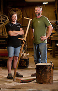 Amy and Allen Wilson, co-owners of the Marugg Company, stand with a finished sickle on display at the Marugg Company where handmade scythes and sickles are manufactured in Tracy City, Tenn. The Marugg Company was founded in 1873 and has made thousands of european style scythes and sickles used for cutting grass and harvesting crops. <br /> &copy; Dan Henry / BiciPhoto.com