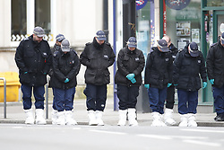 © Licensed to London News Pictures. 03/02/2020. London, UK. Police search teams scour Streatham High Road the day after a terrorist stabbed two people before he was shot by armed officers. Sudesh Amman, who was released from prison recently for terror offences, was under active police surveillance at the time of the attack - which police think was an Islamist-related terrorist incident. Photo credit: Peter Macdiarmid/LNP