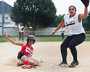 Gibbstown's Sydney Coleman scores on a past ball as West Deptford's Brittany Short waits for the ball during a game Thursday July 7, 2011 held at the  Clayton Little League Complex.