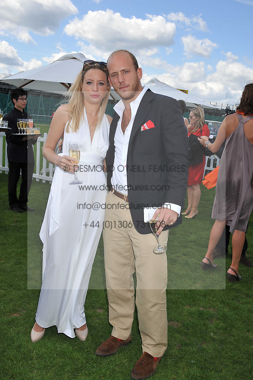 CARLO CARELLO and  SOPHIA WINNINGTON the 27th annual Cartier International Polo Day featuring the 100th Coronation Cup between England and Brazil held at Guards Polo Club, Windsor Great Park, Berkshire on 24th July 2011.