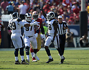 Los Angeles Rams inside linebacker Cory Littleton (58) celebrates with defensive tackle Aaron Donald (99) and defensive end Morgan Fox (97) during an NFL football game, Sunday, Oct. 13, 2019, in Los Angeles. The 49ers defeated the Rams 20-7. (Dylan Stewart/Image of Sport)