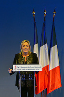 Marine Le Pen speaks from the podium at the far-right National Party's 15th congress on November 30, 2014 in Lyon, France. Le Pen won 100 percent backing to remain chief of the party, founded by her father and predecessor Jean-Maire Le Pen. Marine Le Pen is expected to make a bid for the country's presidency in 2017. (Photo by Bruno Vigneron/Getty Images)