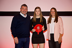NEWPORT, WALES - Saturday, May 19, 2018: Layla Howells is presented with her Under-16's cap by Osian Roberts (left) and Lauren Dykes (right) during the Football Association of Wales Under-16's Caps Presentation at the Celtic Manor Resort. (Pic by David Rawcliffe/Propaganda)